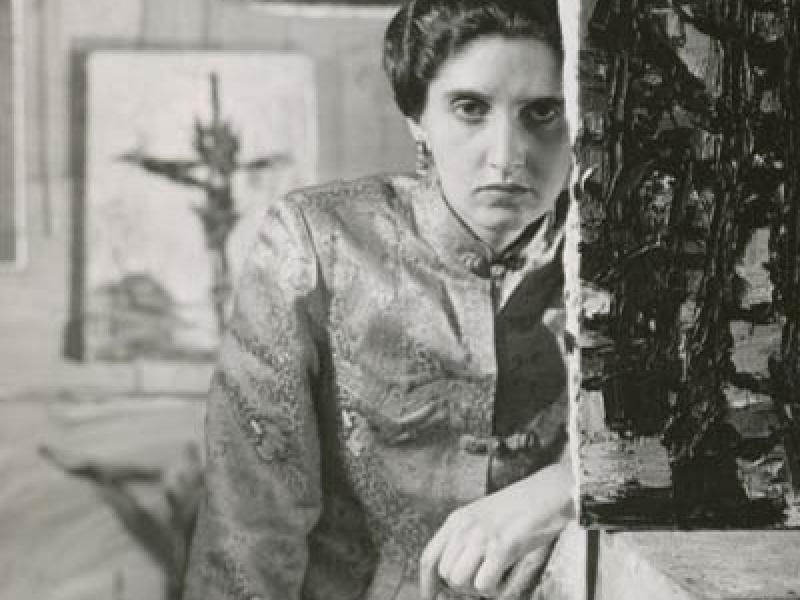 Soshana with painting wearing Cheong Sam jacket | Paris 1957