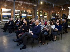 Visitors listening to the opening-speech